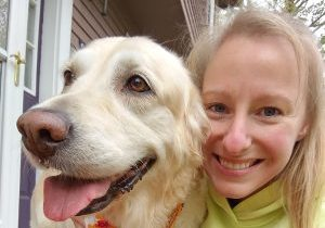 Nicole Swanson posing for a closeup picture with her dog