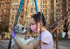 iStock-girl-with-dog-at-playground_HAI-scaled