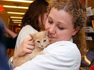Woman with cat at Foster Hospital